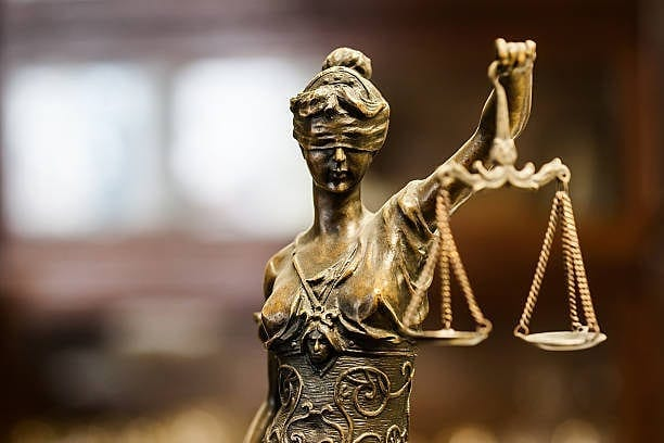 Lady of Justice Calgary - Shory Law - Calgary